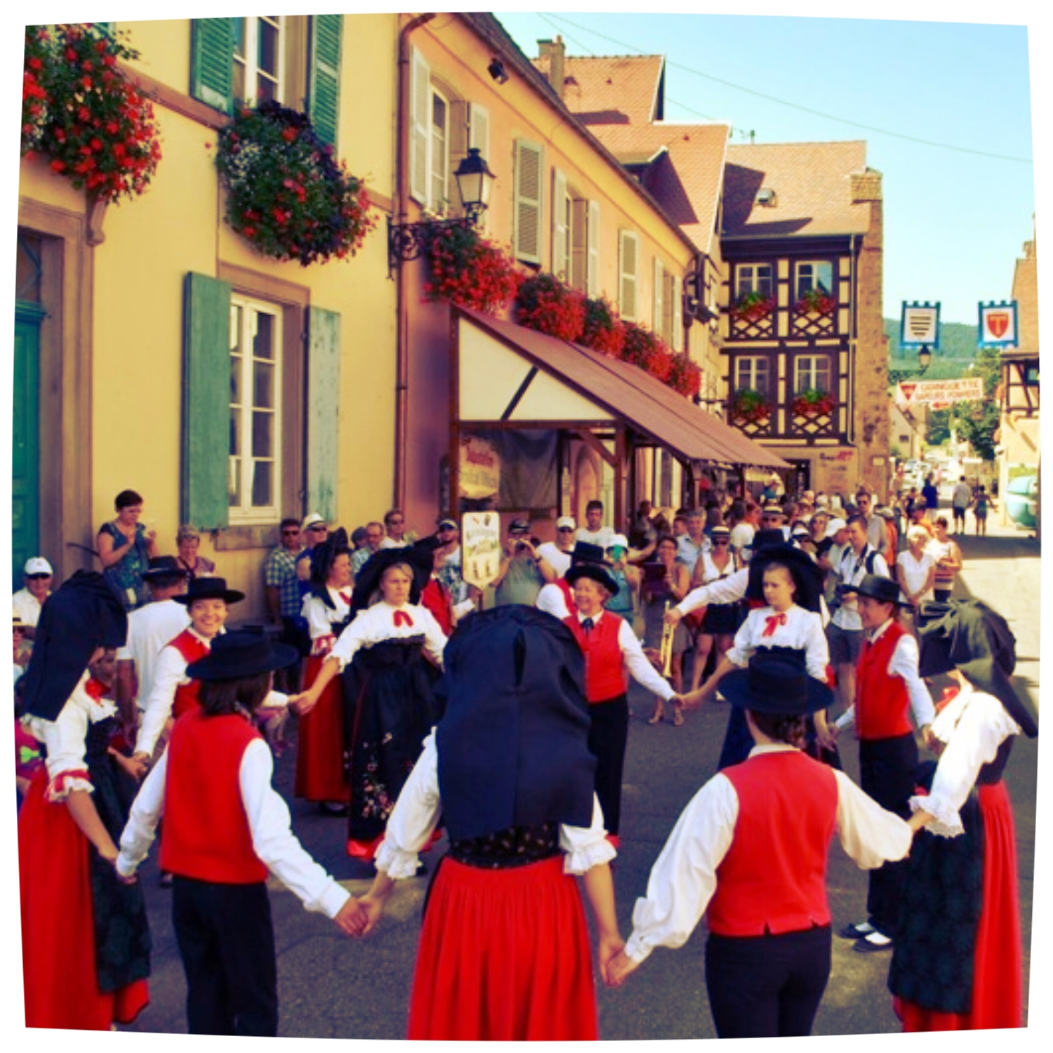 Going to local festivals while traveling is always a great way to REALLY experience local life.  But if you go to a WINE festival, it's even greater! For the total sum of €3/person in Eguisheim, Alsace we got enter the village's harvest festival and try wines from a dozen local wineries (including Grand Cru wines!), enjoy dancing, traditional costumes, delicious local cuisine, and an opportunity to hang with the locals!