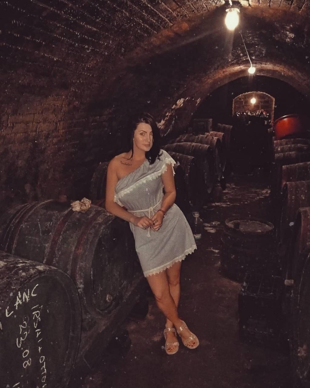Exploring an old wine cellar.