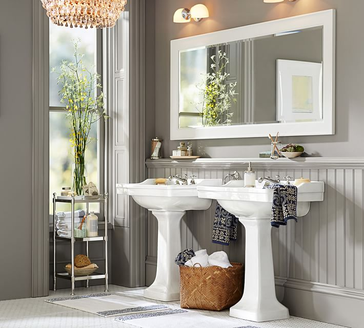 New lighting, fresh paint and a hand-painted framed mirror transform a bathroom. Photo: Pottery Barn.
