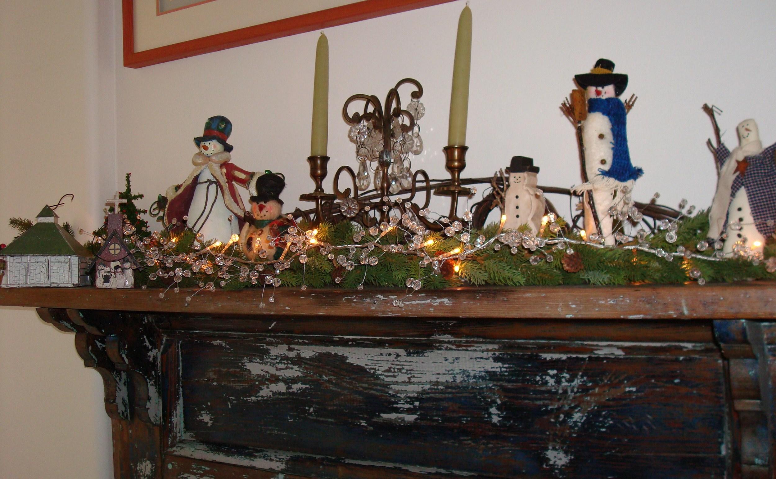 Snowmen on antique mantle