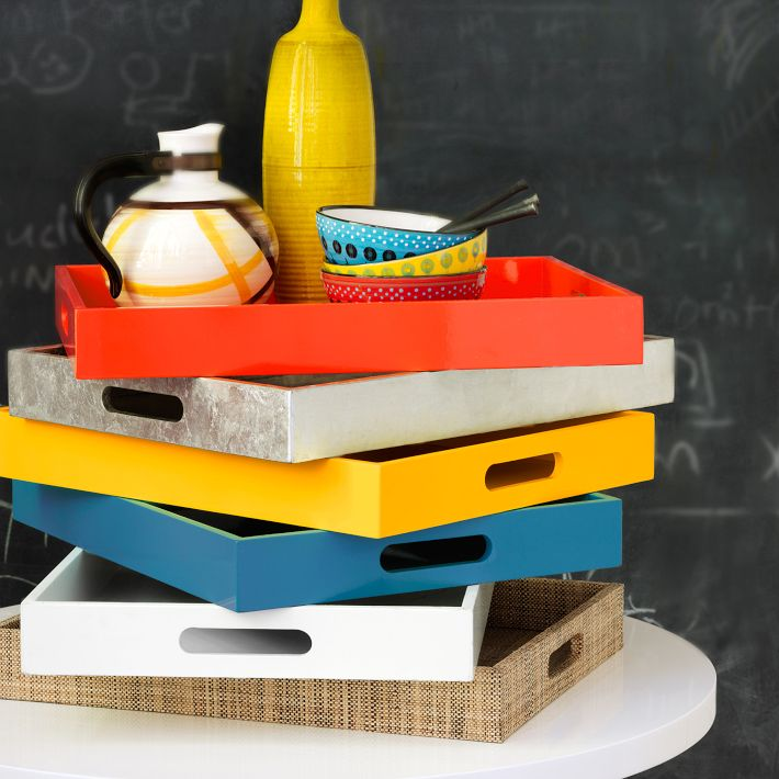 Lacquer trays in bold shades multi-task to serve drinks, organize odds and ends on a dresser or hold a stack of books on a coffee table. Photo: West Elm.