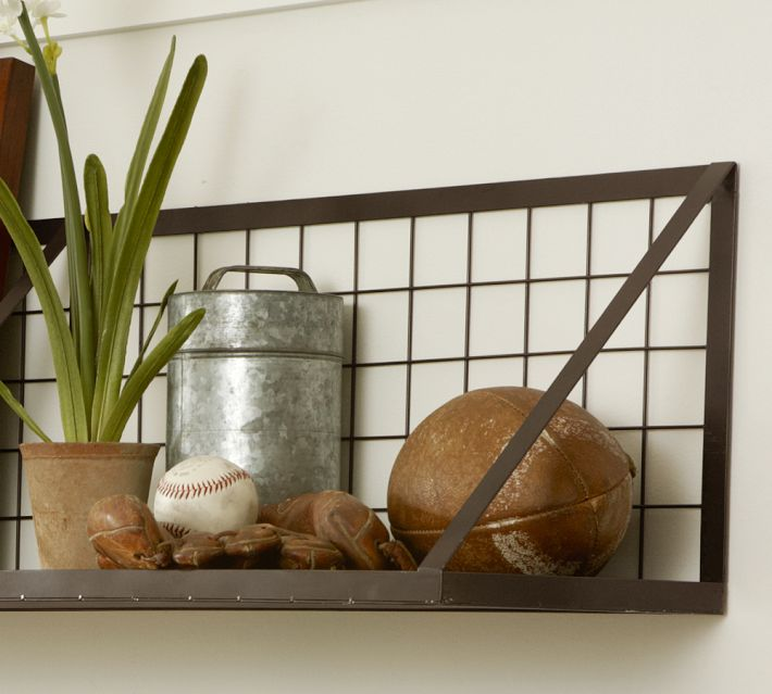 Don't let great memories become clutter. Display them on a wall with this wire mesh shelf from Pottery Barn.