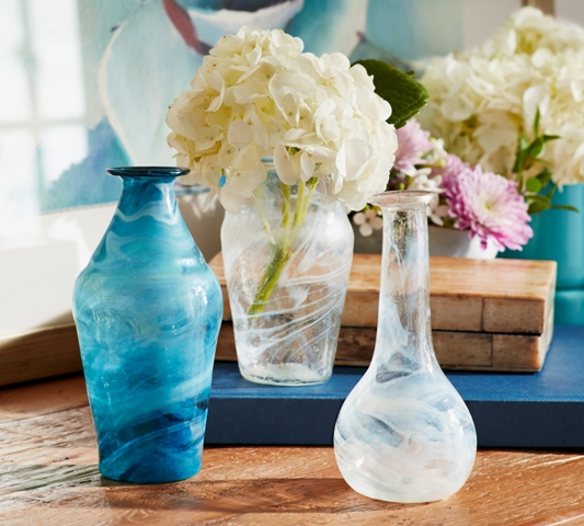 Bring springs colors into your home with marbleized bud vases. Photo: Pottery Barn.