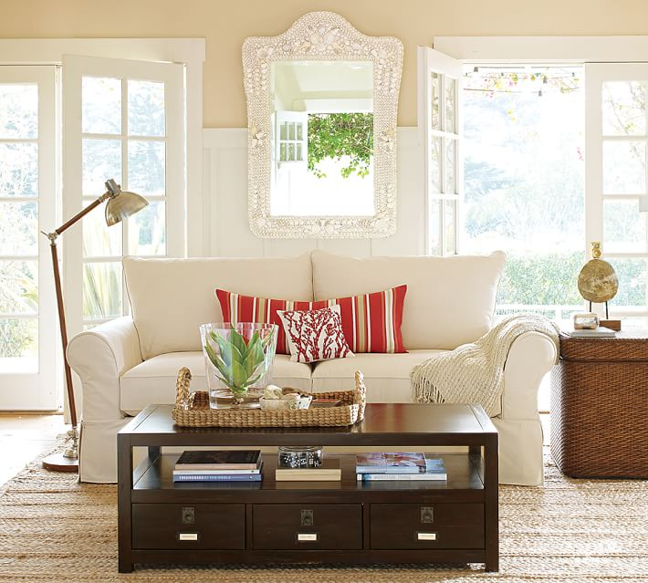 Stage your coffee table and make it the focal point of the room. Photo: Pottery Barn.