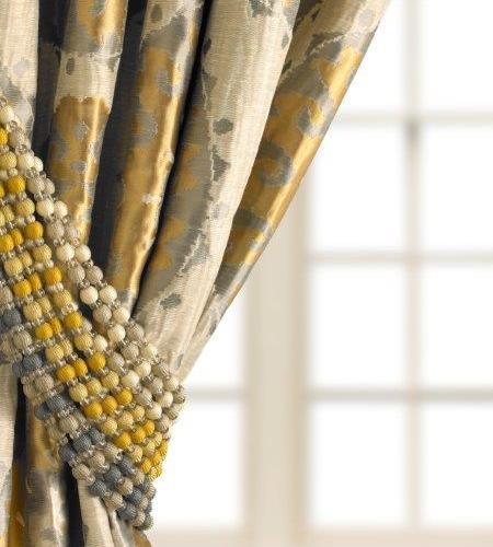 Beaded tiebacks add a designer touch to draperies. Photo: Kravet.