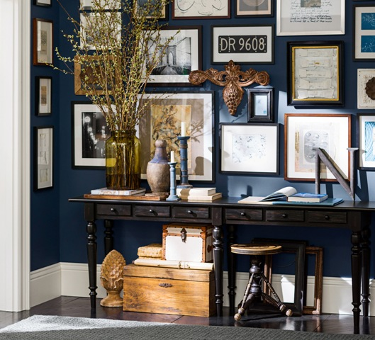 "Make a statement in an entry with a bold accent wall in Sherwin-Williams ""Naval"" for Pottery Barn."