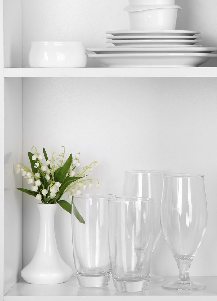 clean-interior-decor-porcelain-dishes-crystal-flatware-on-white-shelves-66623576-1500px.jpg