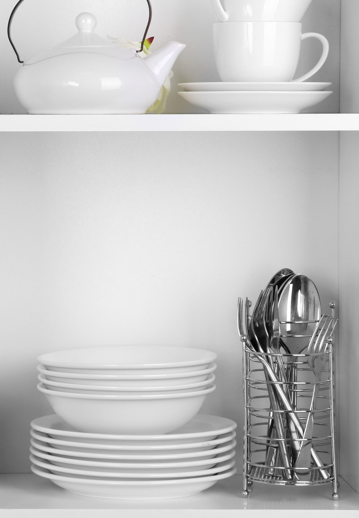 clean-interior-decor-porcelain-dishes-crystal-flatware-on-white-shelves-66623576.jpg