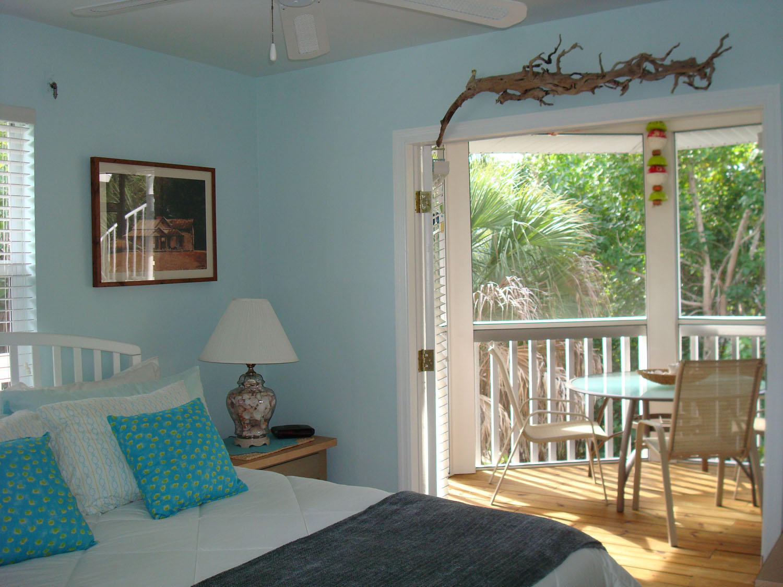 island-beach-house-renovation-bedroom-deck-with-table-doorway-horizontal-11.jpg
