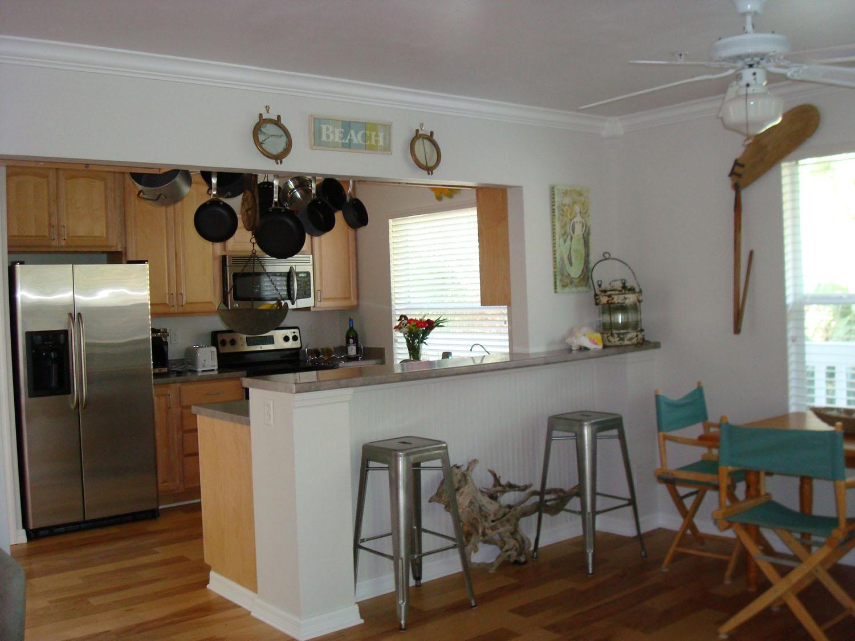 island-beach-house-renovation-kitchen-dining-barstools-05.jpg