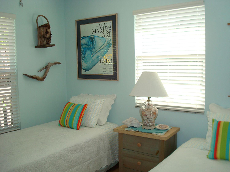 island-beach-house-renovation-twin-beds-bedroom.jpg