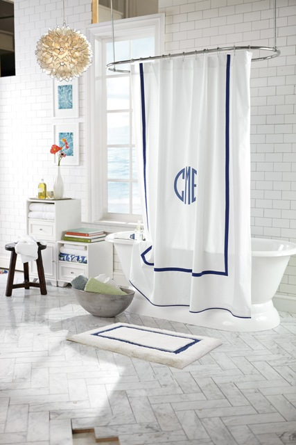 For a spa look, try this Morgan shower curtain of soft cotton with a band of color, along with organic cotton towels. Photo: Pottery Barn.