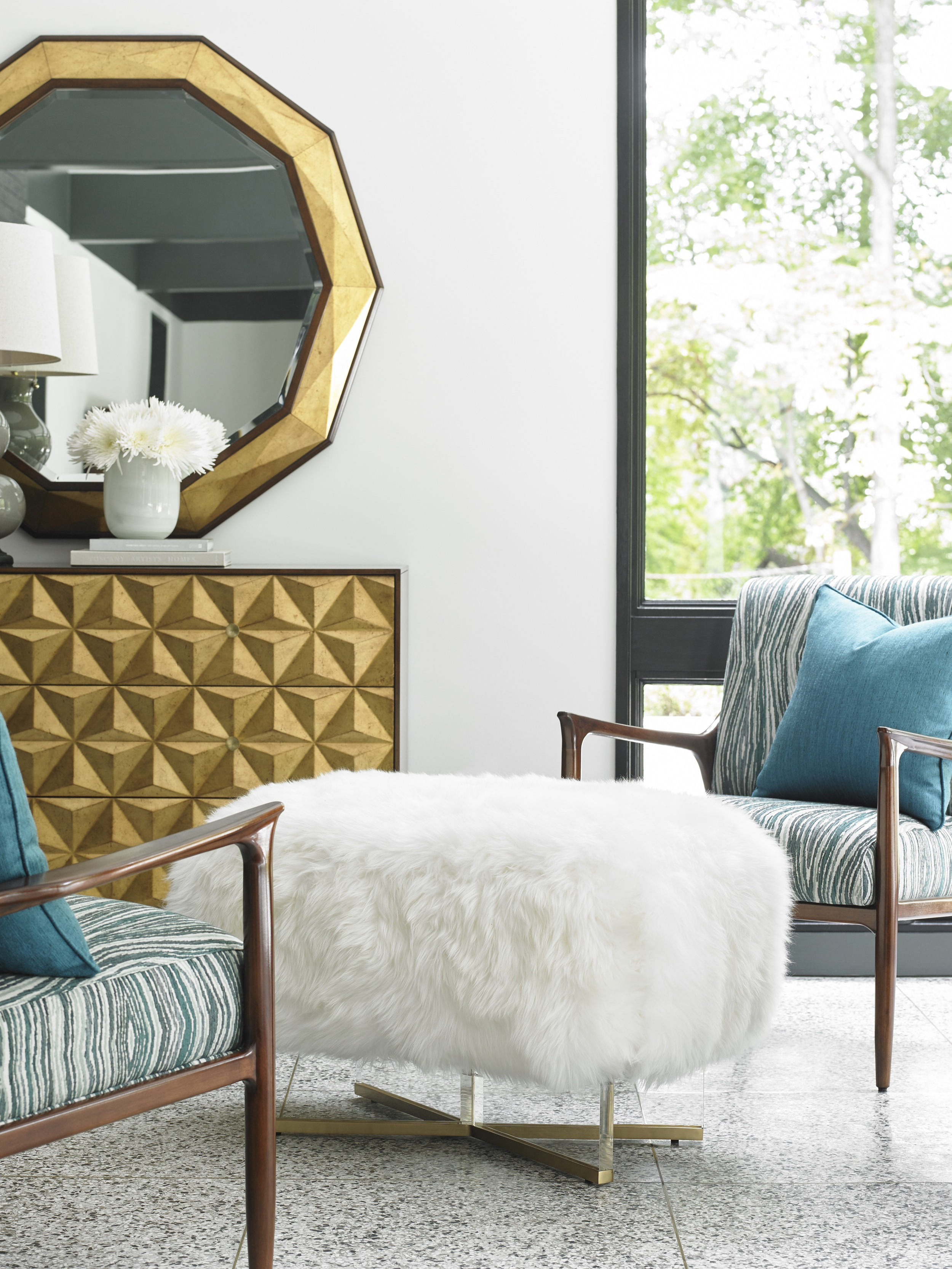 A chic ottoman with a brass-plated stainless steel base and polished acrylic legs, upholstered in Australian sheepskin. From Lexington Home Brand's Take Five Collection. Photo: Courtesy of Lexington Home Brands.