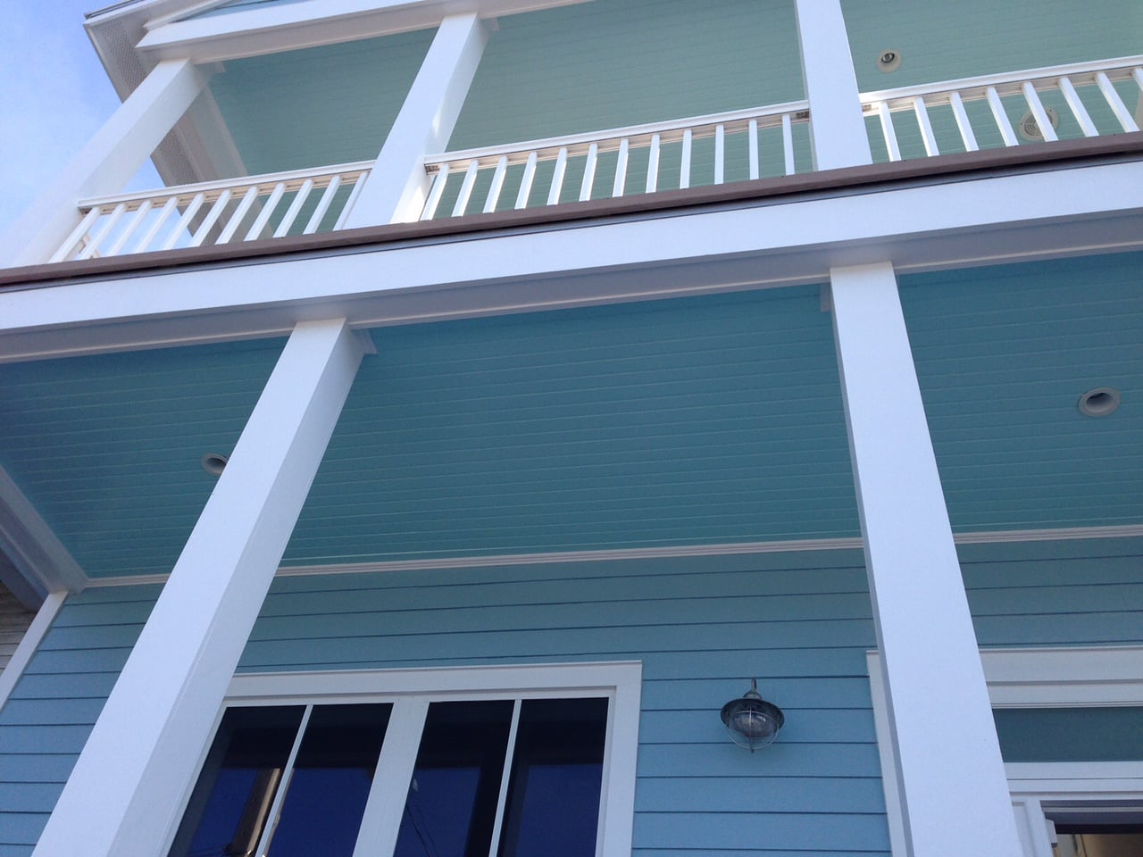 Paint the porch ceiling a shade of blue. It's pretty and legend says that it keeps wasps away! Photo: Wrenda Goodwyn