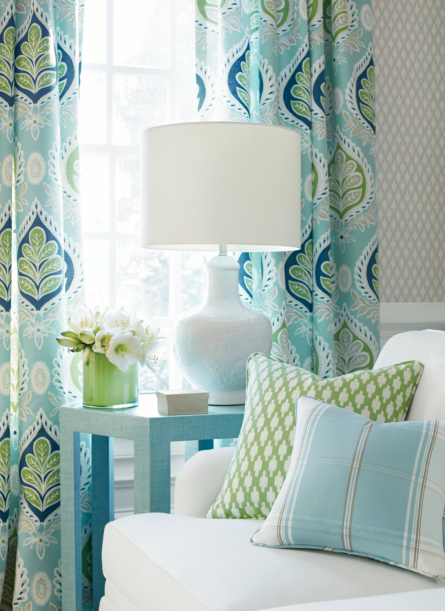Try something new with color with this perky blue and green setting with a large-scale graphic pattern ( Midland ) that has a leaf-like motif and gives a nod to old Federal style wallpaper. The wallcovering shown here is  Troy , a small-scale texture with characteristics of a basket-weave. Photo credit: Courtesy of Thibaut. www.thibautdesign.com