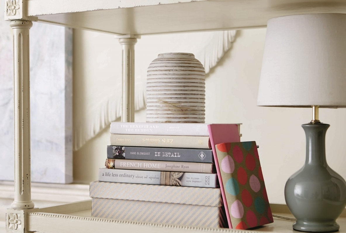 Inspired by an antique she found in Paris, Susan Kasler's bookcase from Ballard Designs is finished in the classic Louis style with fluted details and hand carved florettes. Perfect for your favorite books. Photo courtesy of Ballard Designs.