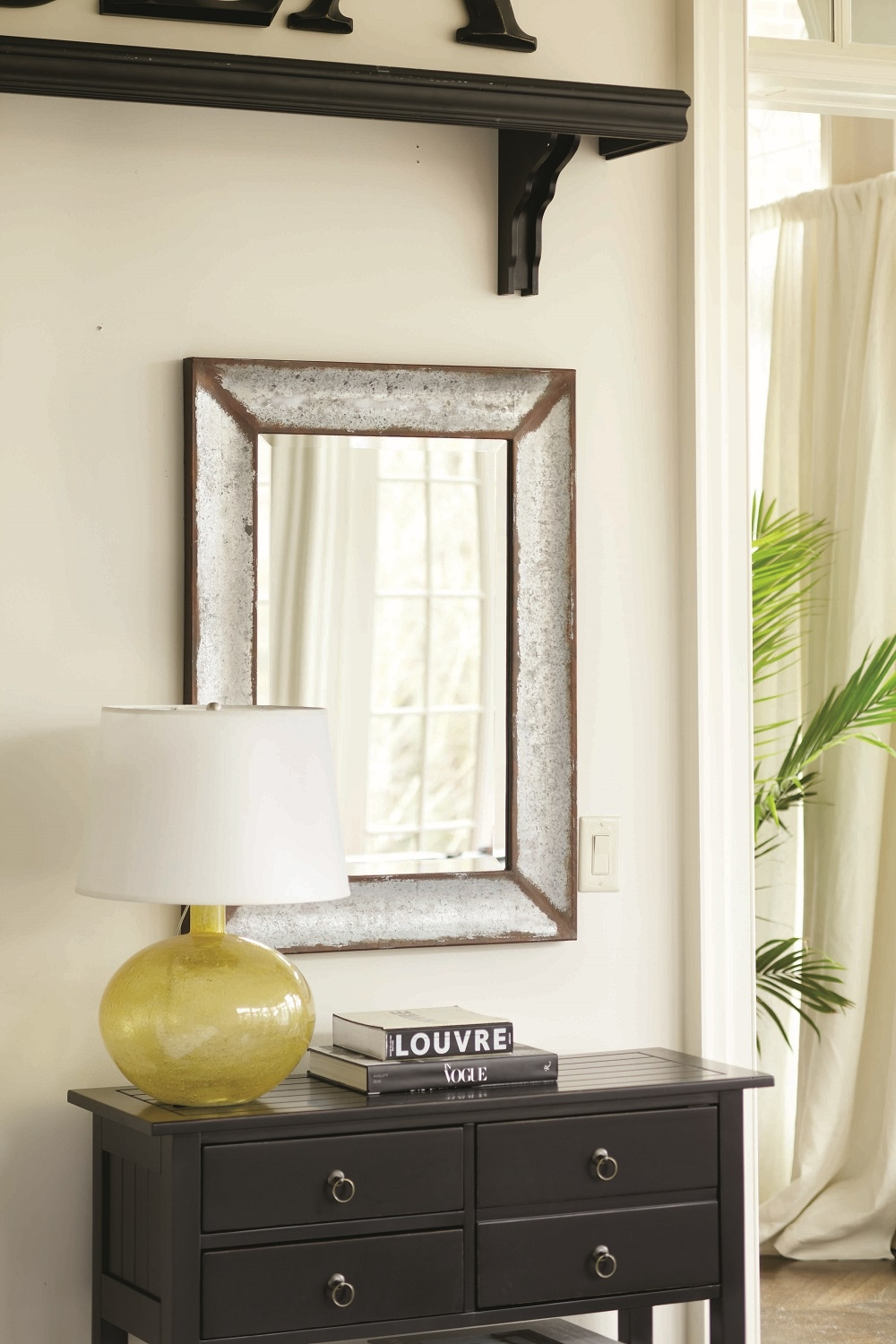 The rustic weathered finish of this zinc framed mirror reminds us of the metal flower pots you see outside the country houses of southern France. The mirror has wide bevel for light-catching contrast. Frame is hand crafted of galvanized metal and may be hung or leaned on a wall. Photo courtesy of Ballard Designs.