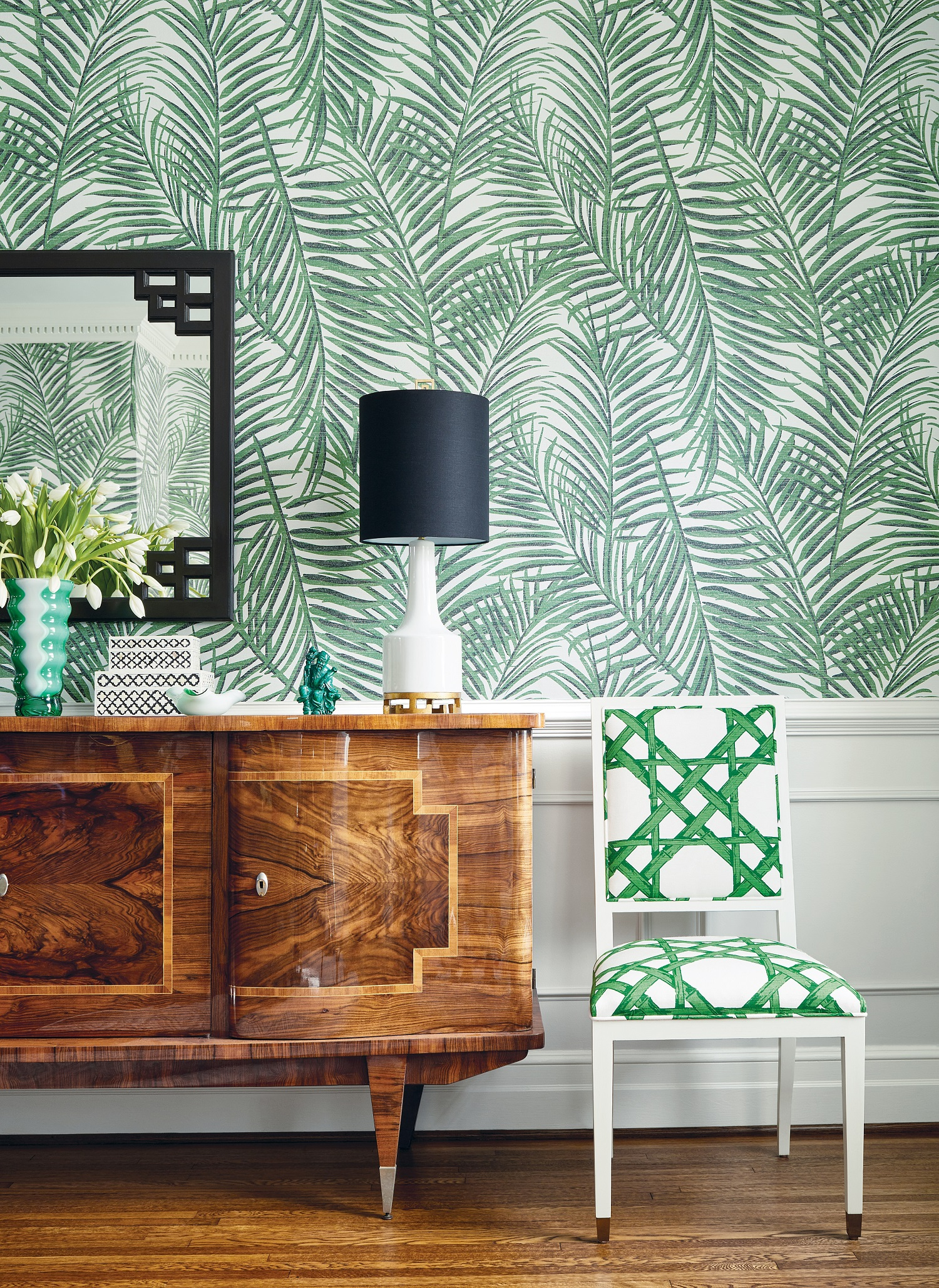 Bring the greenery indoors with  West Palm  grasscloth wallpaper in emerald green paired with Lauderdale chair in emerald green  cyrus cane  fabric.  Photo courtesy of Thibaut Design.