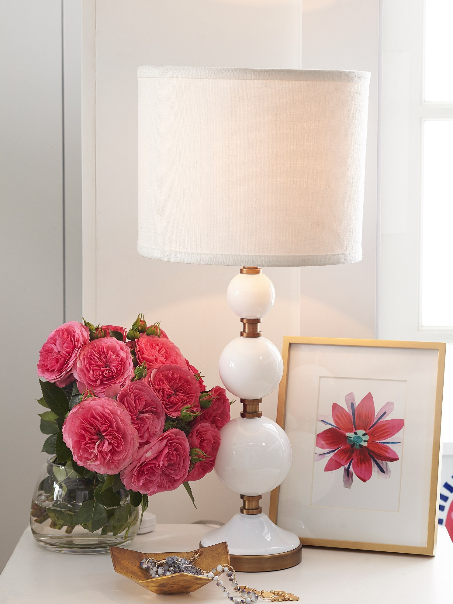 Stacked bubbles make this Tilda Bubble Lamp from Pb Teen, a playful accent on a bedside table or dresser. Featuring hand blown glass and a linen shade, paired with flowers and artwork, it will brighten your space with a relaxing and whimsical glow. Photo courtesy of Pottery Barn.
