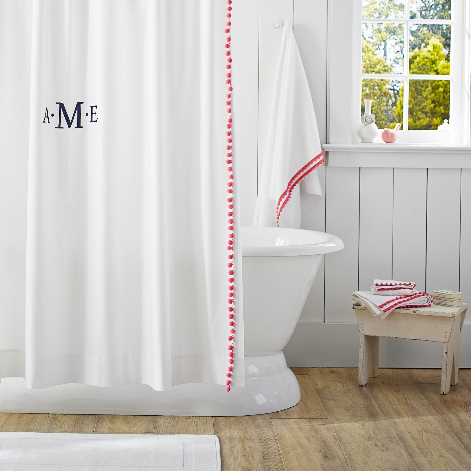pom-poms line the edge of this sheer panel to provide a bath with a pop of playful color. From Pb Teen. Photo courtesy of Pottery Barn.
