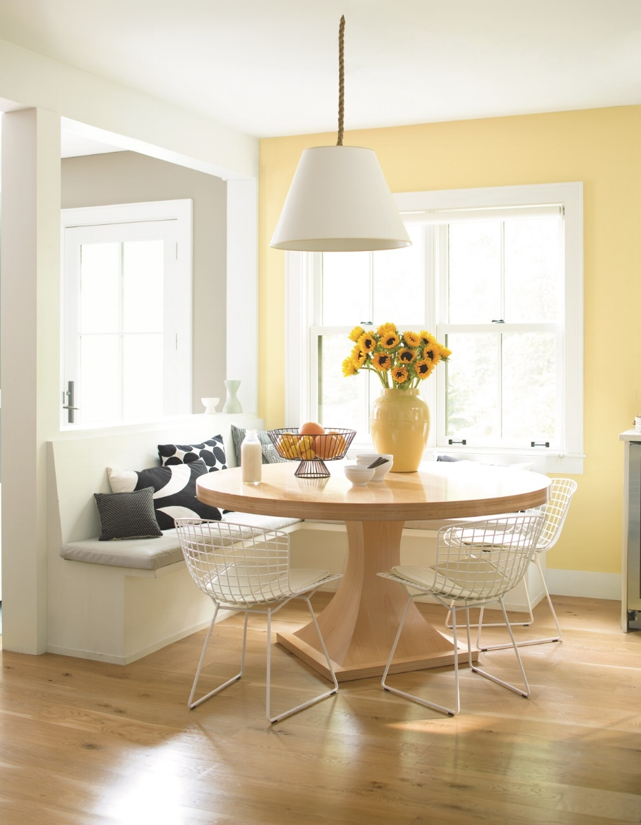 It's hard to resist this kitchen accent in Benjamin Moore's Hawthorne Yellow. It works well with all of the white trim, ceilings and the white banquette and chairs. And the lemons and sunflowers! Photo: courtesy of Benjamin Moore.