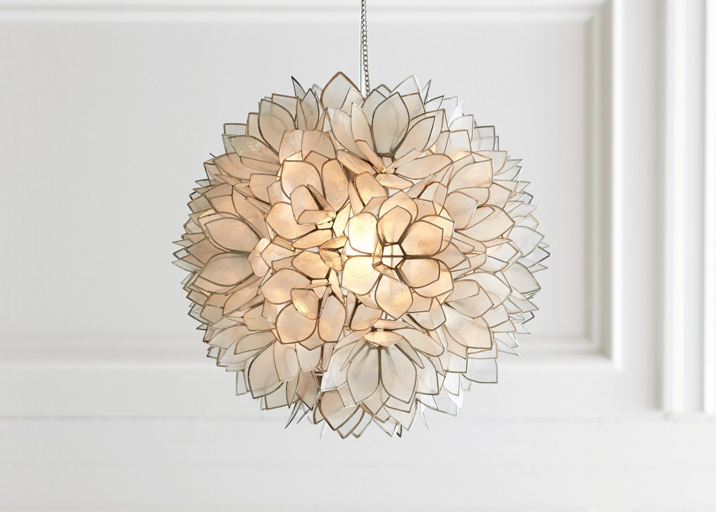 Pick out a favorite accessory like this capiz pendant with hundreds of shell petals from a luminous lotus flower. Photo: courtesy of Pottery Barn.