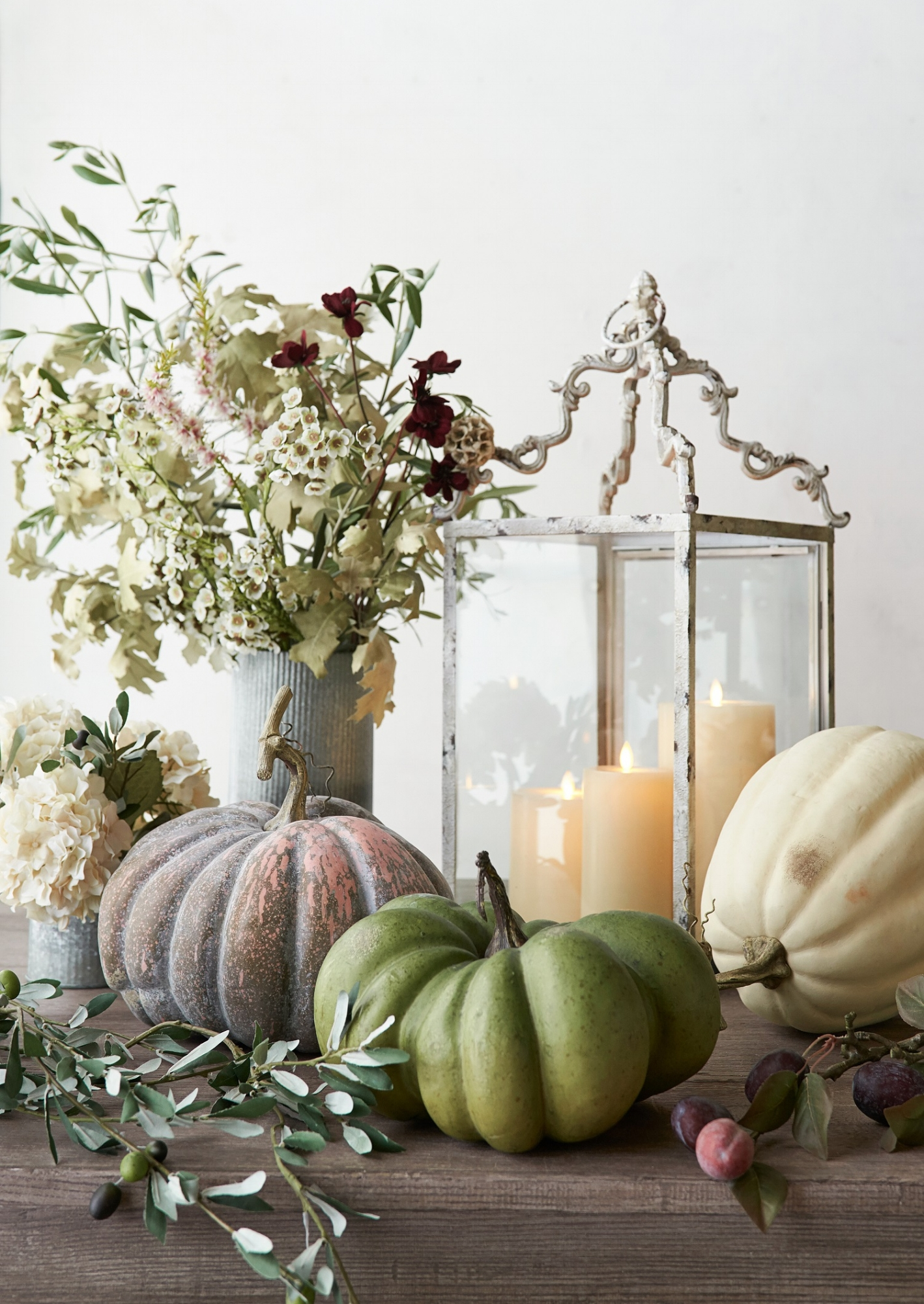Mark the changing of the seasons. Create a fall display with a variety of organic shapes and colors, candle and lantern. Photo courtesy of Pottery Barn.