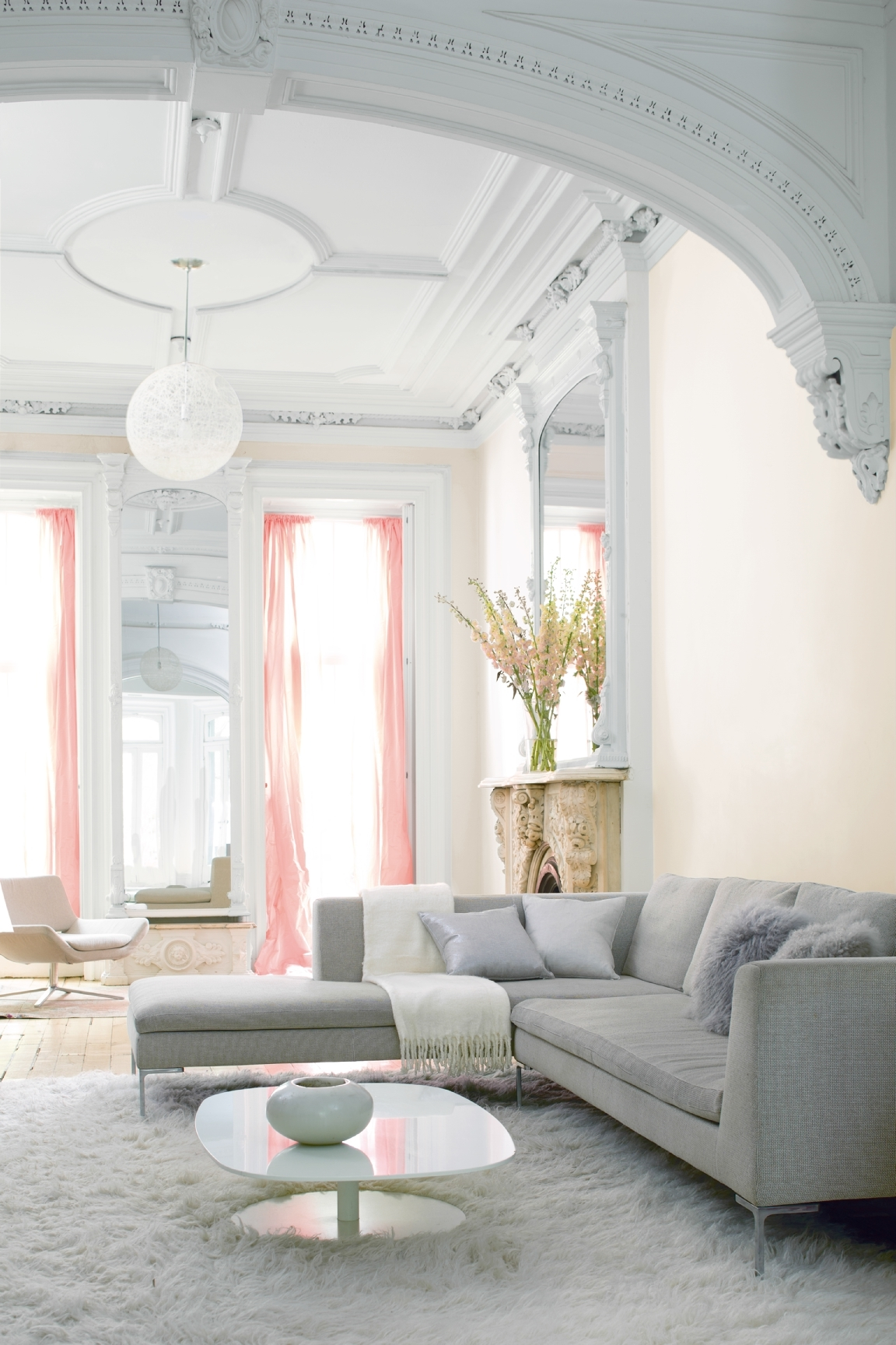 Color changes everything when it comes to a more minimalist decorating style. Shift into neutral by using white as a blank canvas for art and furnishings. Walls are in Benjamin Moore's Pink Damask in eggshell (OC-72) and ceiling and trim in semi-gloss Chantilly Lace in (OC-65).