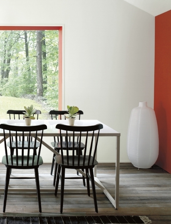 Less is more with Benjamin Moore's Paper White (OC-55) matte walls with a red accent in a semi-gloss Ravishing Red (2008-10). All pulled together with the black dining chairs. Photo: Courtesy of Benjamin Moore.