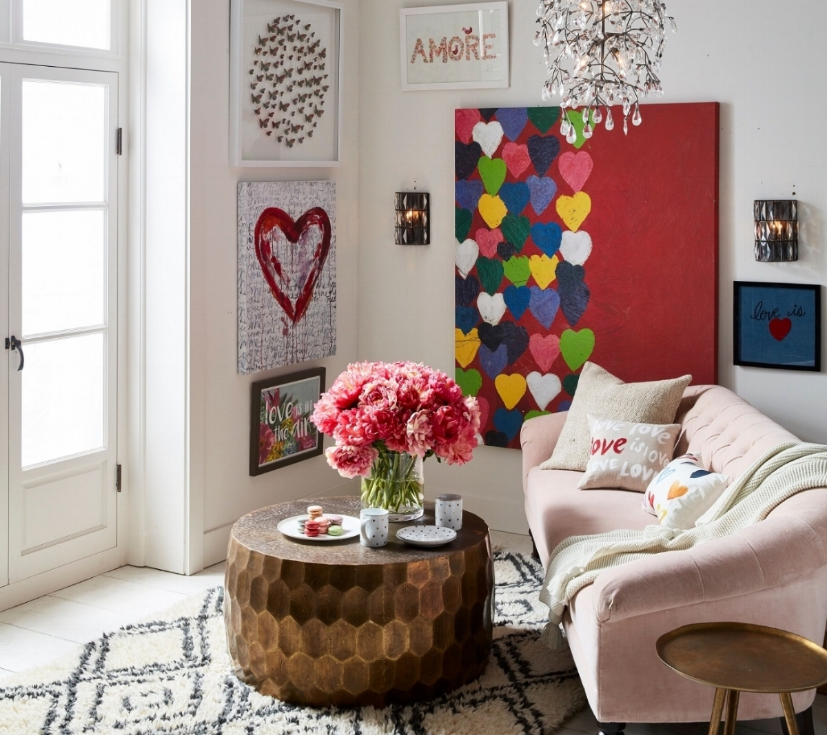Give a little love in 2018 with Pottery Barn's  Love Gallery  art pieces, pillows, Bella crystal round chandelier, Madison upholstered settee and metallic tables. Check out details at  www.potterybarn.com .  Photo courtesy of Pottery Barn.