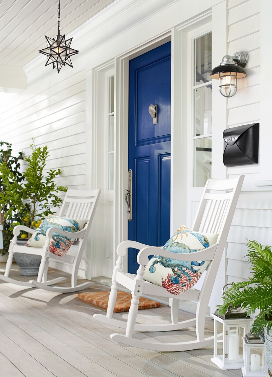 "Say ""welcome home"" with a spring refresh of your front entry with a freshly painted front door in a beautiful blue. Include a weather-resistant Salem rocking chair from Pottery Barn and an Olivia outdoor star pendant. Photo courtesy of Pottery Barn."