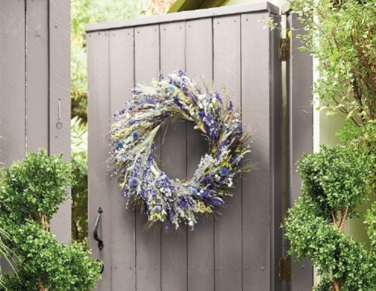 Add a touch of spring with Frontgate's wildflower garden wreath with periwinkle and lavender. Photo courtesy of Frontgate.