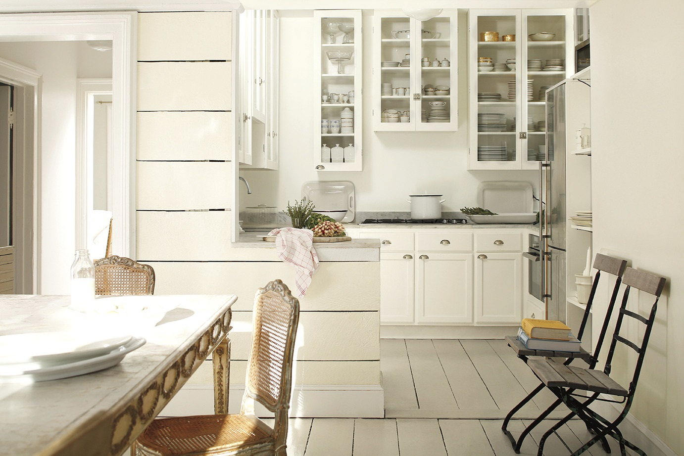 Home buyers love white kitchens, professional appliances and Carrera marble counters. Colors: Benjamin Moore. Walls: Mascarpone in Regal interior eggshell. Cabinets: Simply White in satin.  Photo Credit: Benjamin Moore.