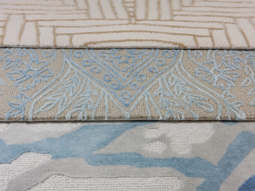 Carpet designer Malene B has created hand-knotted and hand tufted rugs that make a statement with a mixture of texture and color. Made in Nepal by skilled artisans, each is crafted by hand and no two are alike. The muted colors pair well with bright fabric choices. From Kravet to the trade. Photo courtesy of Kravet.