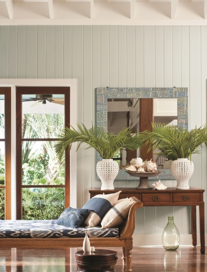 Benjamin Moore's popular Palladian Blue HC-144 sets the tone for this coastal-inspired room with a chaise and palms. Photo: Benjamin Moore.