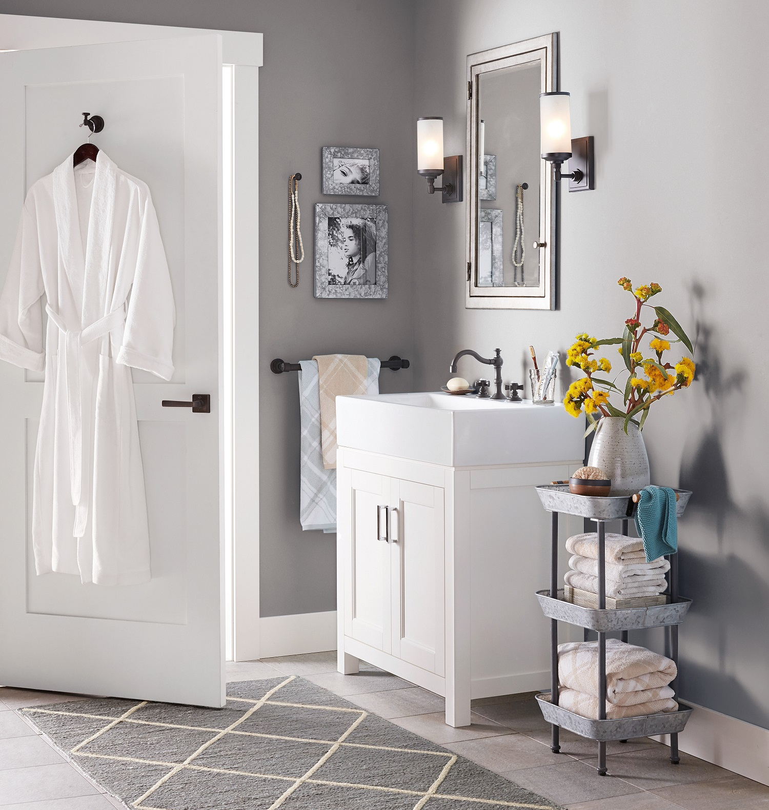 Renovating or adding a powder room? There are a lot of details to consider. Fixtures, space planning, color. Design element for this small bath is Pottery Barn's modern farmhouse sink. Photo: Pottery Barn.