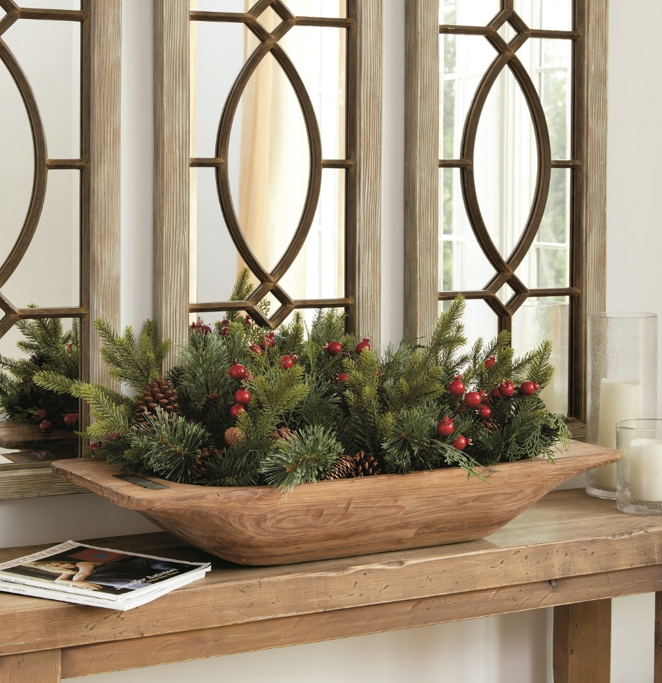 Use what you have! Fill a bowl with greenery, ornaments or collectibles for a smaller entry space. Or use this lush Christmas greenery filler that fits the popular classic dough bowl from Ballard Designs. Photo: Ballard Designs.