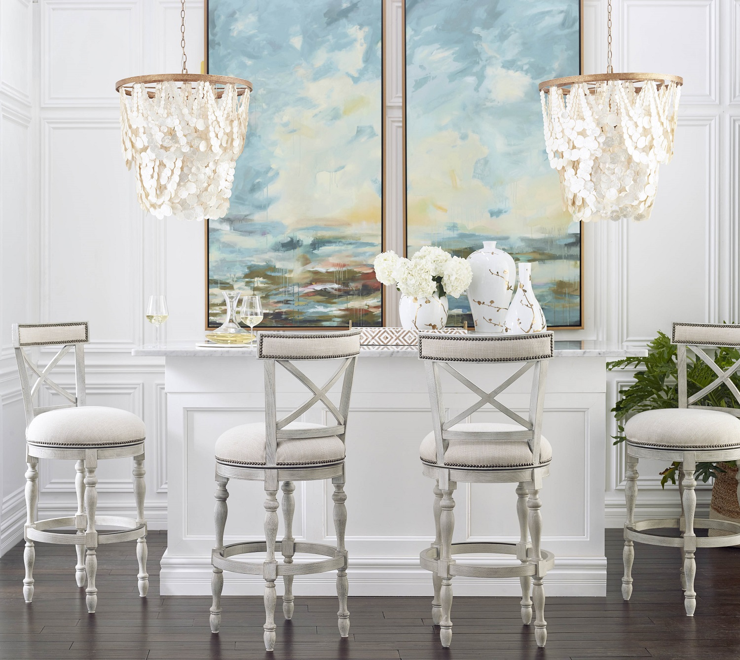 When it comes to a fresh, new look for the New Year, it's all in the details. Carefully planned furnishings, artwork, lighting and accessories that all work together. Shown: Frontage's Griffith X-back swivel bar stools in linen or leather, beautiful Carmel-by-the-sea giclee print on canvas and gilded blossoms hand-painted ceramic vase collection. Photo: Frontgate