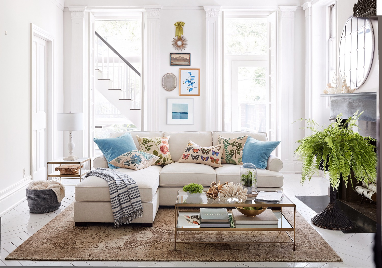 Give your living room sofa a new look with a few spring pillows that become the focal point of the room. Always select a couple of solid colors to mix with patterns and flowers. Shown: Townsend sofa with reversible storage. Photo: Pottery Barn