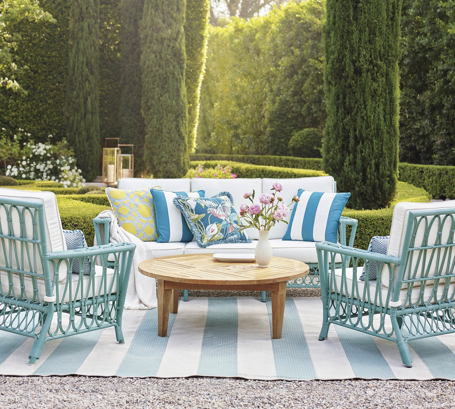 Frontgate's Myla collection brings a laid-back coastal vibe to any outdoor setting. All-weather resin wicker is intricately handwoven in an open looped pattern around durable powder coated aluminum frames. Add a rug to tie the area together. Photo: Frontgate