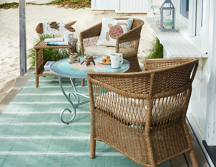 Anchor the space with a rug. Even small spaces are perfect for summer days. Check out Pier 1's Coastal Collection. Photo: Pier 1.