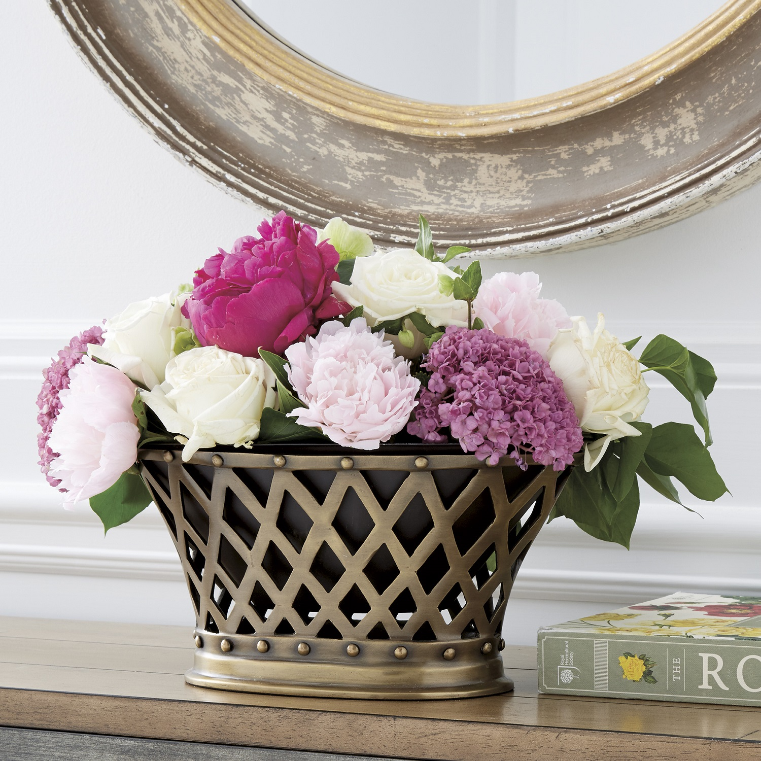 Scaling back means that you can say more with less in your home. Renowned designer, Bunny Williams has an oval lattice-style cachepot like this one resting on the mantel in her New York apartment. She designed this version for Ballard Designs with a watertight, removable iron liner so you can fill it with freshly cut stems. It's perfect for smaller centerpieces. Photo: Ballard Designs.