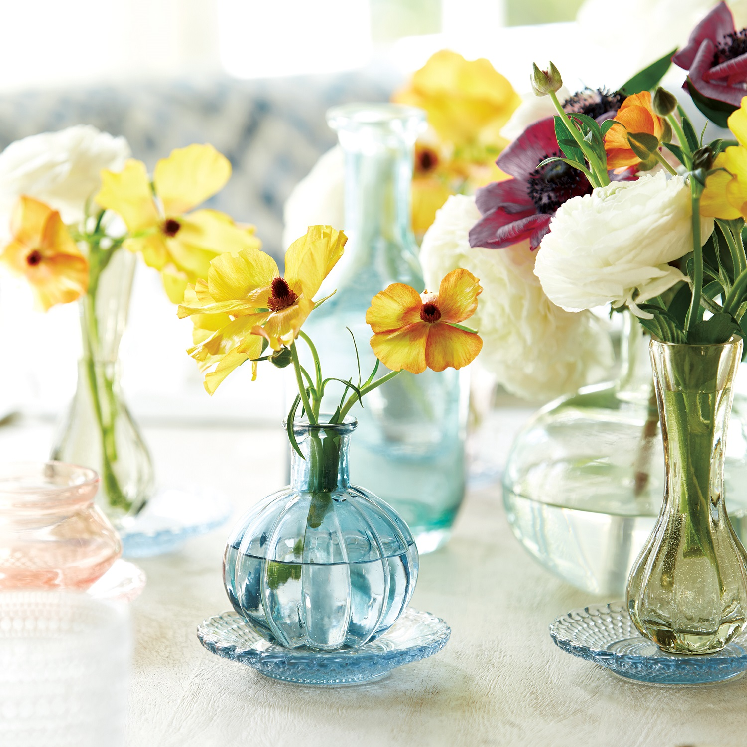 Getting rid of what you no longer use (decluttering), gives you space for something new and pretty, like flowers. Shown: Melissa bud vases from Ballard Designs.