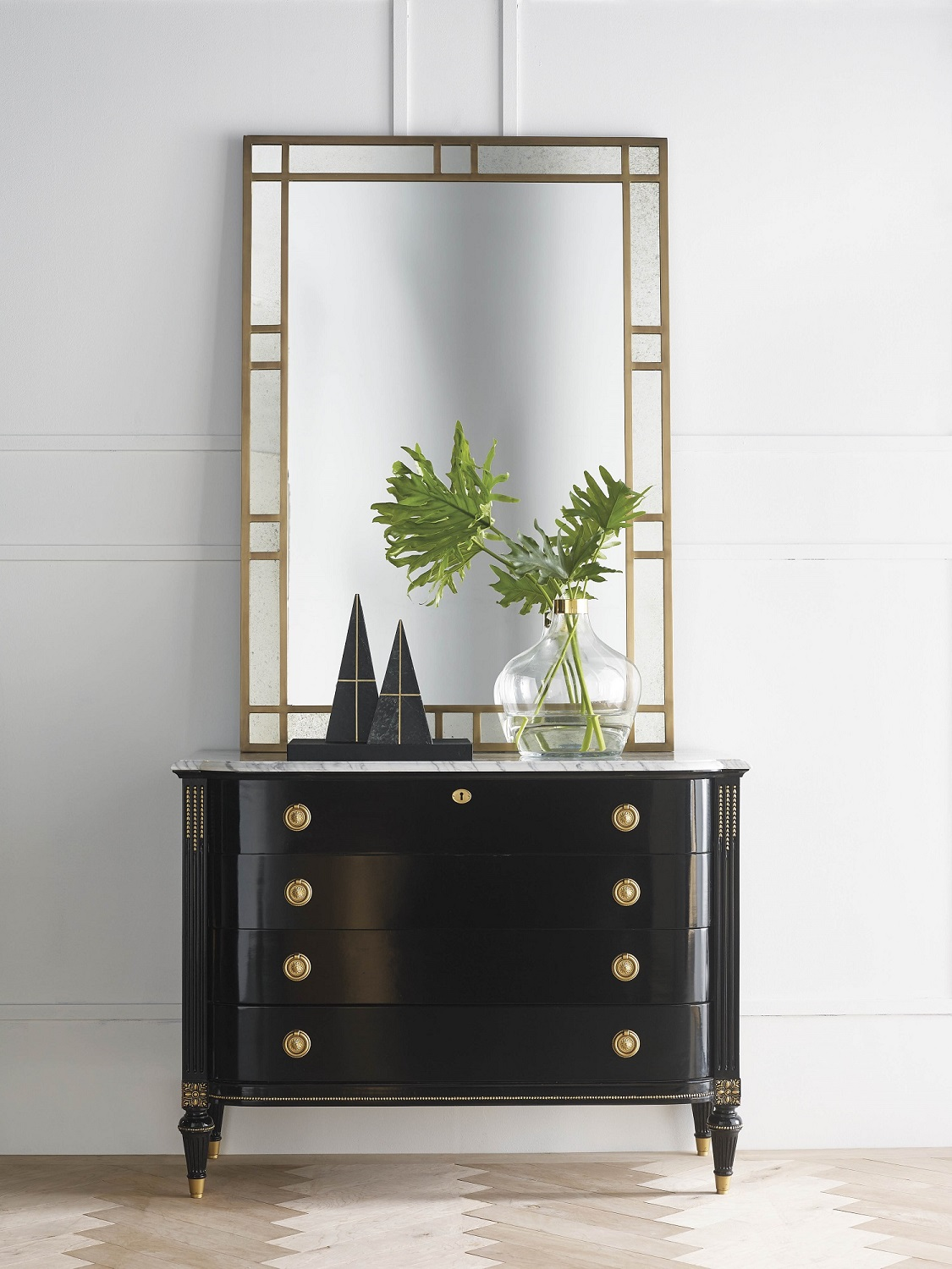 Simplify your accessories and let your favorite pieces speak for themselves. Shown: Frontgate's Regency 4-Drawer Bow Front Chest pays homage to a neoclassical antique. The hand-painted gold beading catches the eye almost as quickly as do the bow-shaped drawers, hand carved corners, and veined Carrara marble top. Photo: Frontgate.
