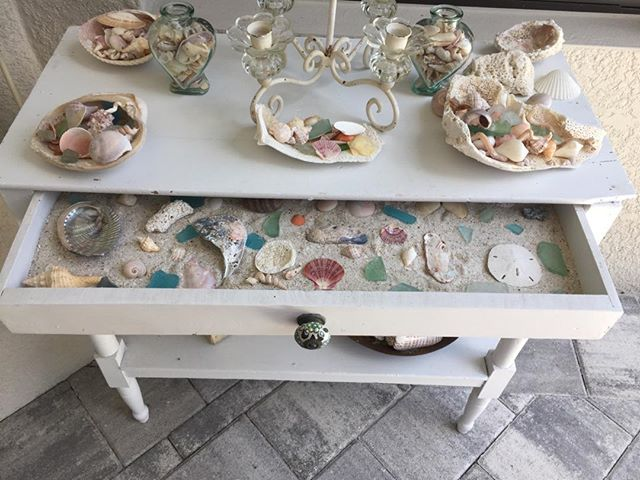 A coat of white paint and a new ceramic drawer pull makes this antique market find a great way to display a shell collection. Just fill drawer with sand and add your favorite shells!  #shellabrate #homedecor #styleyourhome #homesweethome #homeinspiration #loveyourhomeagain #southwestfloridadecorator #styleyourhome #colorchangeseverything #interiordecorating #affordabledesign