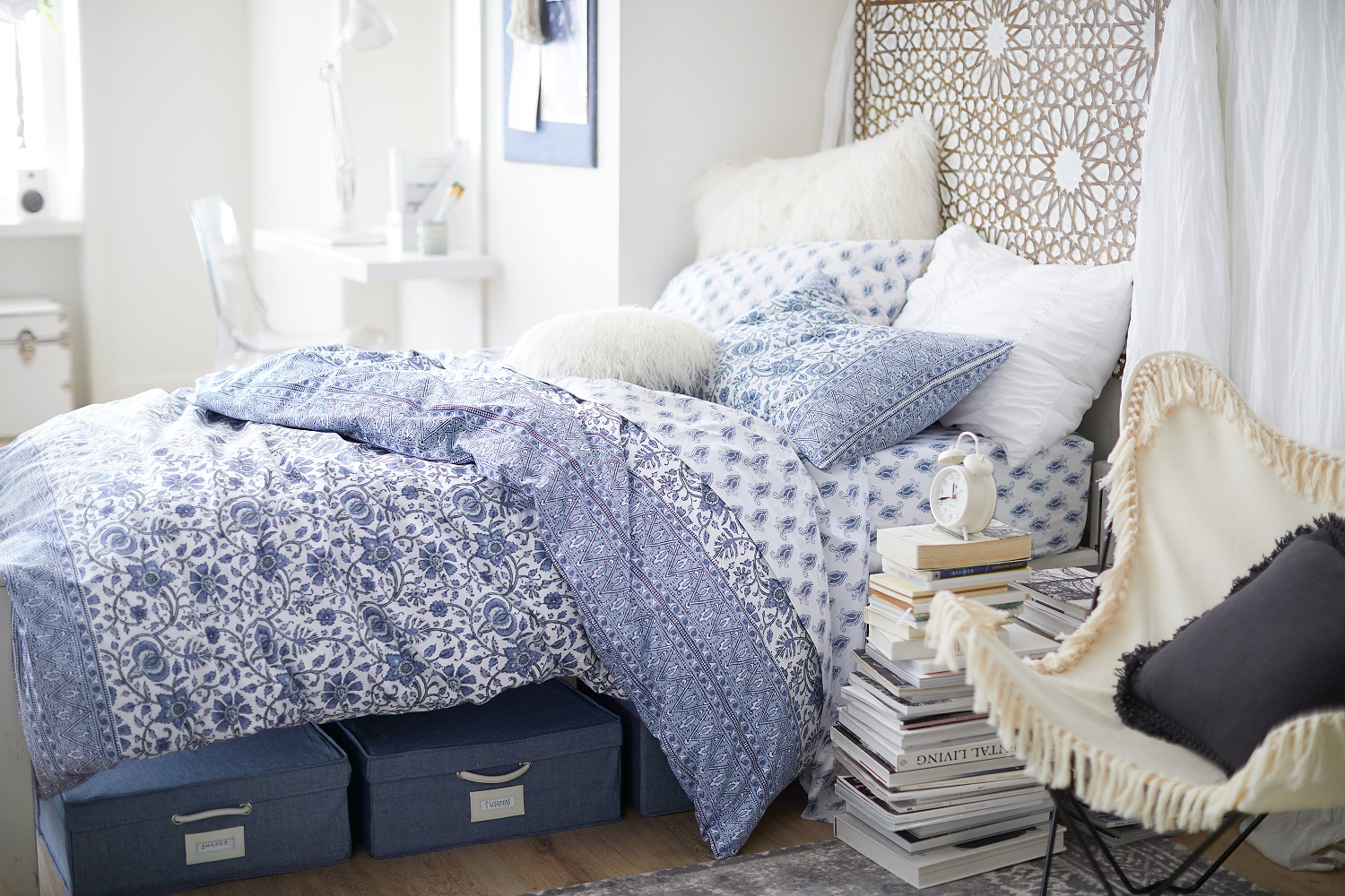Under-the-bed storage, a pretty and practical comforter, wall décor and a comfy chair all help to pull the dorm room look together. Elevate the look of your sleep space with patterns and paisley! Pottery Barn bundles everything from mattress pad to pillow insert to duvet with all the basics you need to make your best bed. Photo: Pottery Barn