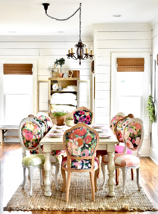Garden party! Change up your dining room chairs with this colorful fabric set against a neutral palette bu Wendy Conklin. Photo: Chair Whimsy