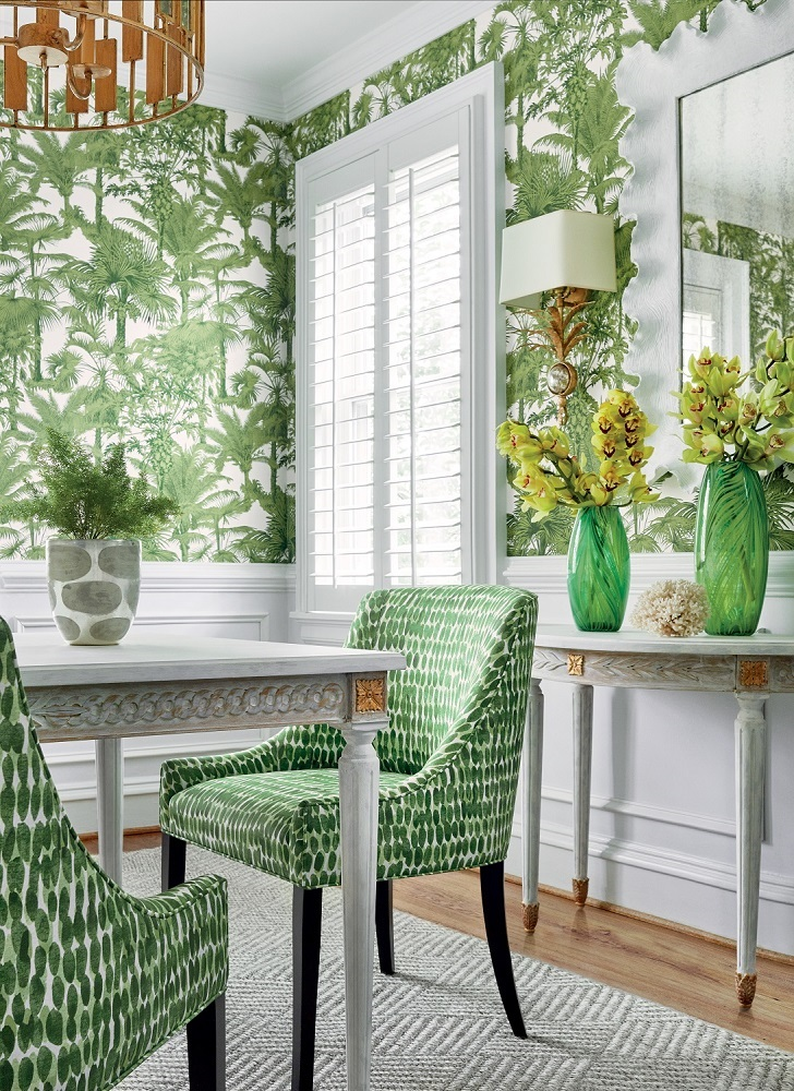 Palm Botanical wallpaper in Emerald Green from Thibaut Design's Tropics Collection. Morgan Dining Chairs in Rain Water printed fabric in Green. Photo: Thibaut Design