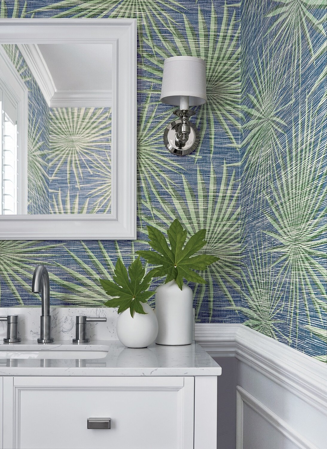 Powder rooms are the ideal spot for pattern and color. And no worries about water contact from showers and baths. Thibaut's Palm Frond wallpaper from its Tropics collection adds a perfect coastal vibe to a home. Photo: Thibaut