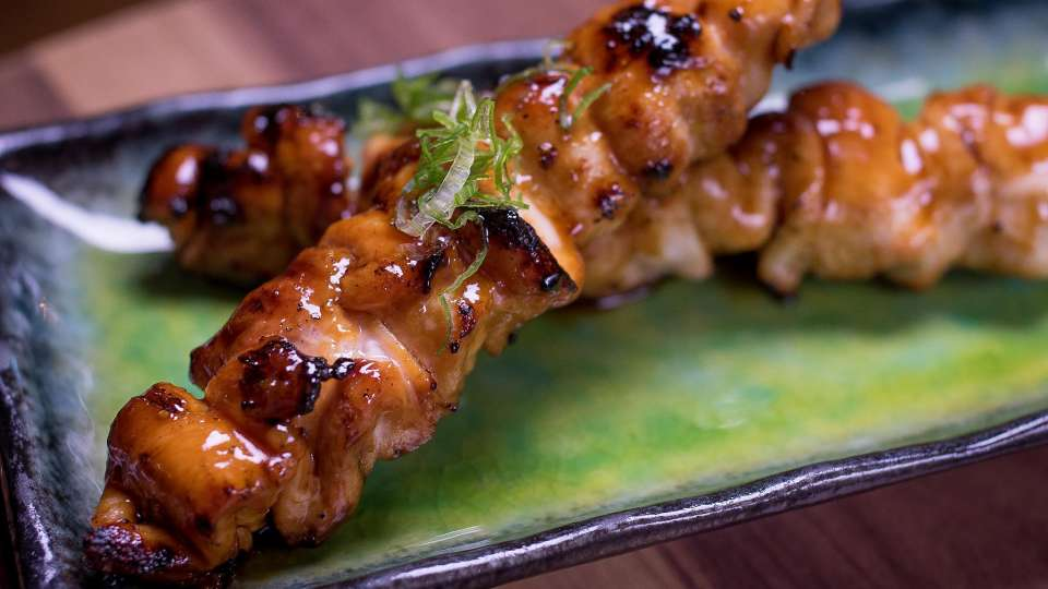 Chicken thigh skewers. Village Sake. Photography by John Storey. SF Chronicle.